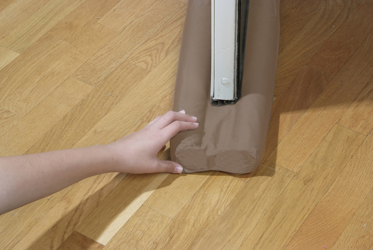 Frost King brand double draft stop simultaneously insulates both the inside and outside of door or window. Eliminates drafts and dust traveling through gap underneath door or window. Works on carpeted or hardwood floors. Durable and safe foam insulating rods secure the washable cover. Easy and quick.